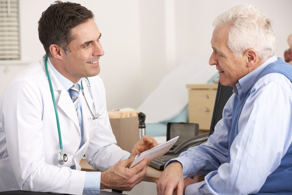 Doctor and senior male patient discussing DBD oil