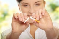 Quit Smoking With CBD woman breaking cigarette