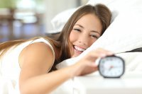 Happy Woman waking up after CBN aided sleep