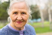 Portrait smiling elderly woman who uses CBD for dementia