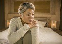 Mature asian woman suffering from fibromyalgia pain