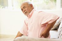Senior Man Suffering From Back Pain due to AS
