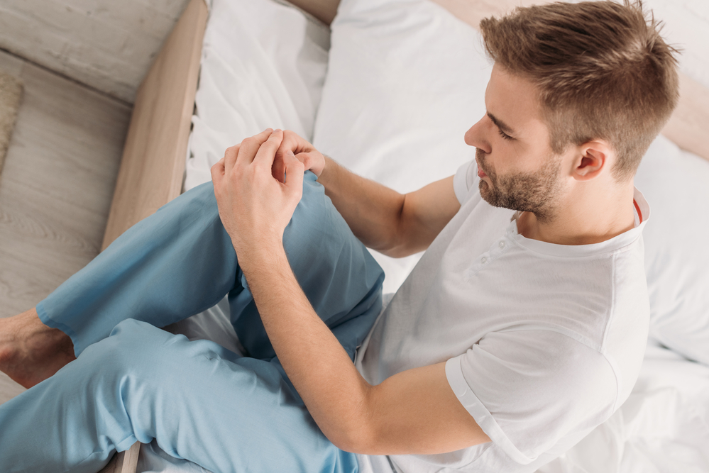 young man using cbd for joint pain relief