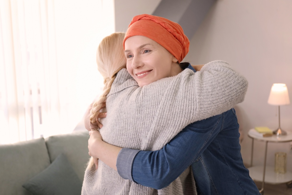 can cbd help cancer. young woman hugs cancer patient.